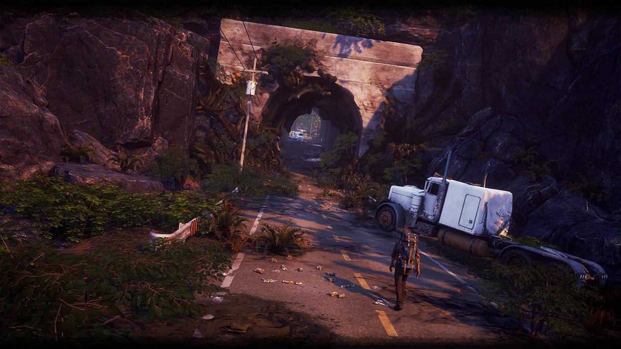 Karakter går på en vei mot en tunell overvokst av gress og en forlatt lastebil