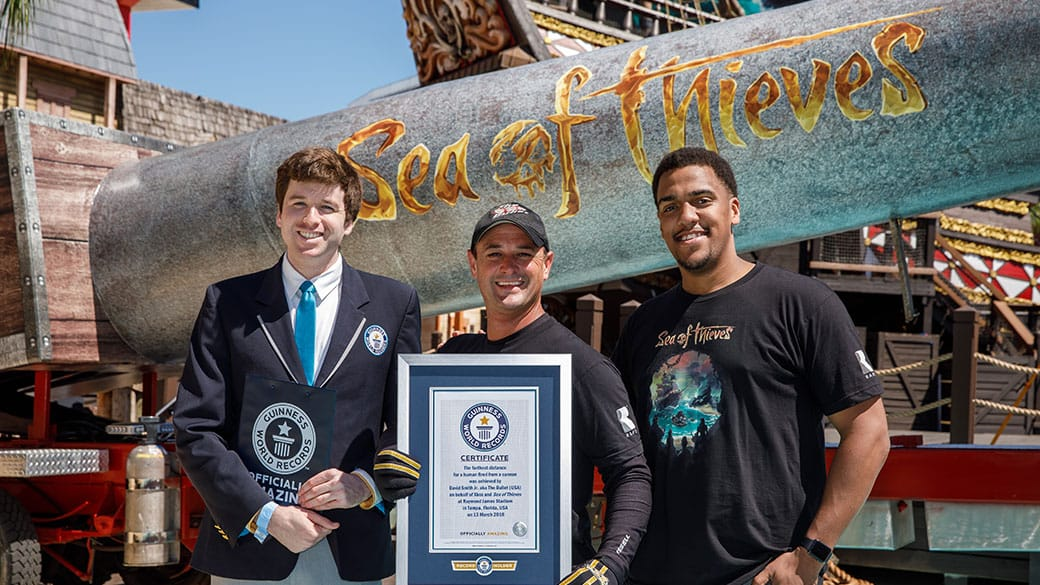 David Smith holding his world record certificate with two other people