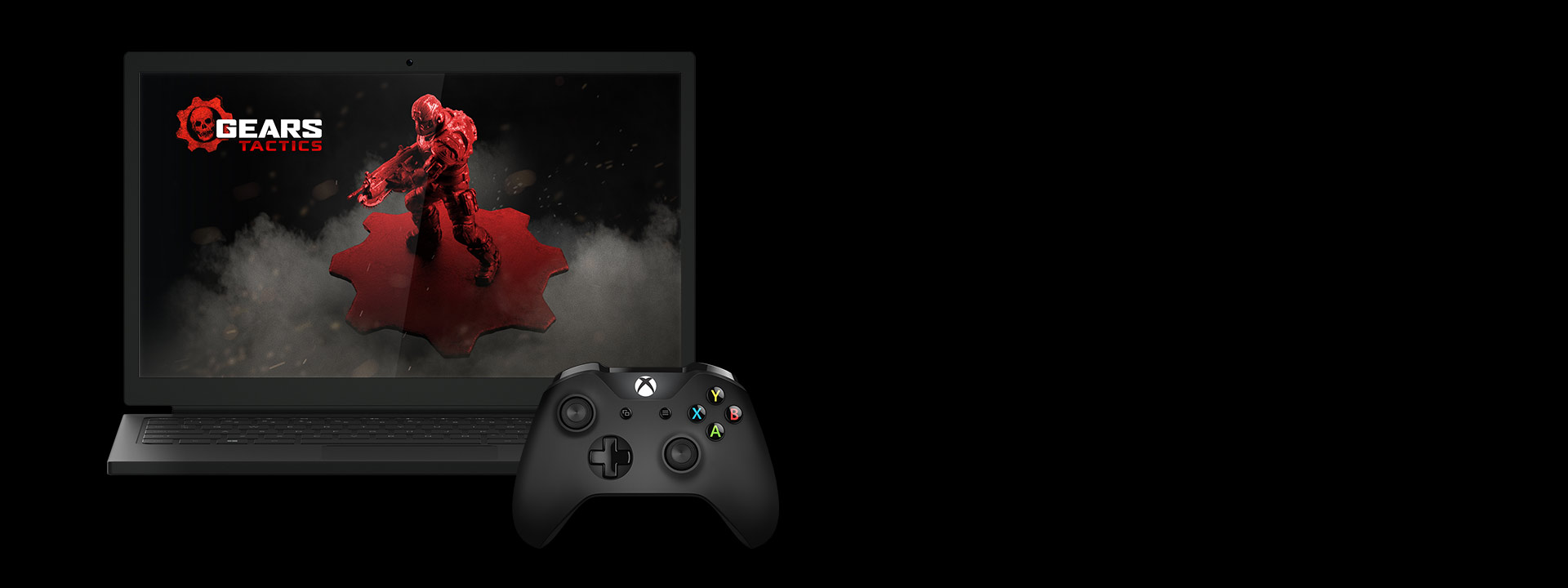 red gears of war miniature on a laptop screen next to an xbox one controller
