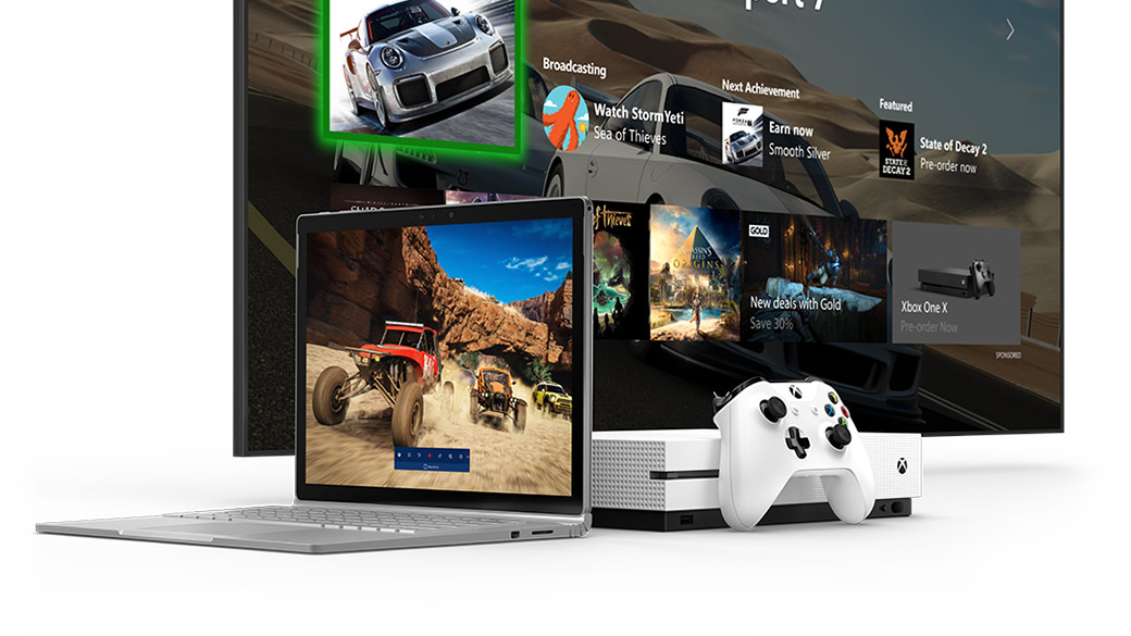 Surface Book, Xbox One S og en TV som viser hjemskjermen for Xbox-dashbordet