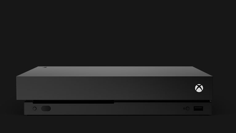 The front view of an Xbox One X console.
