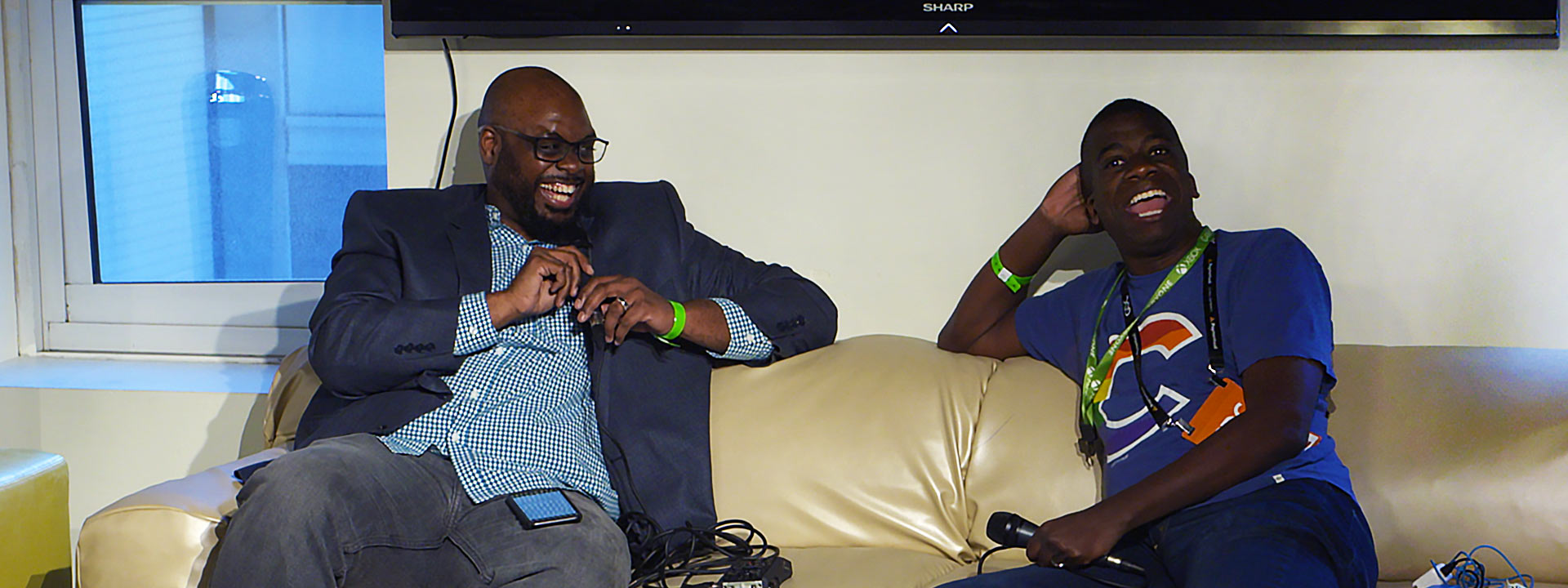 A gaming industry professional from the black community is interviewed on a couch