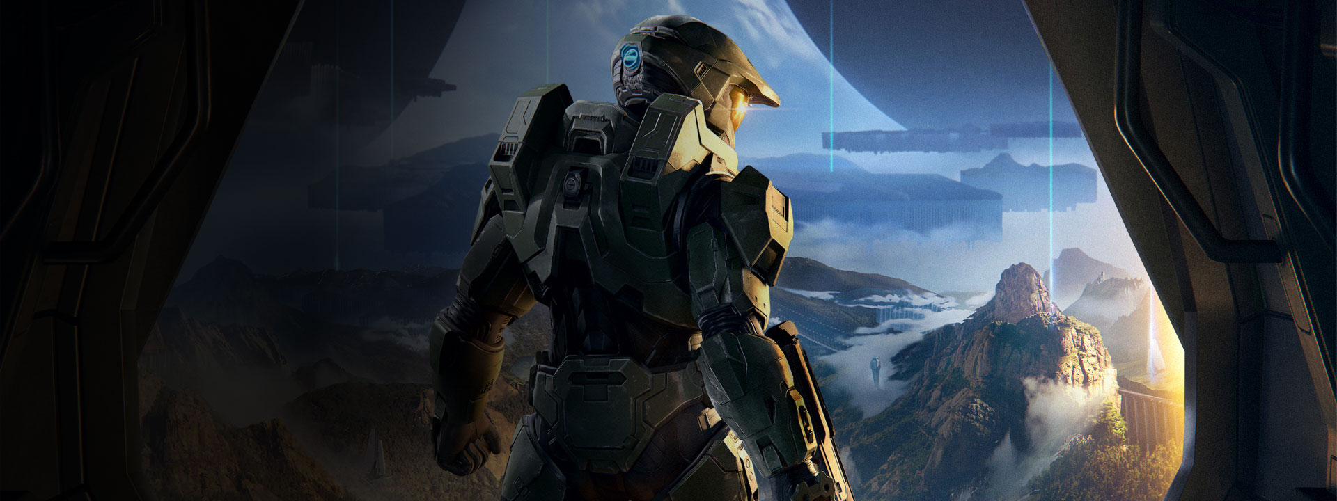 Master Chief looks out on a mountainous landscape from a ship doorway