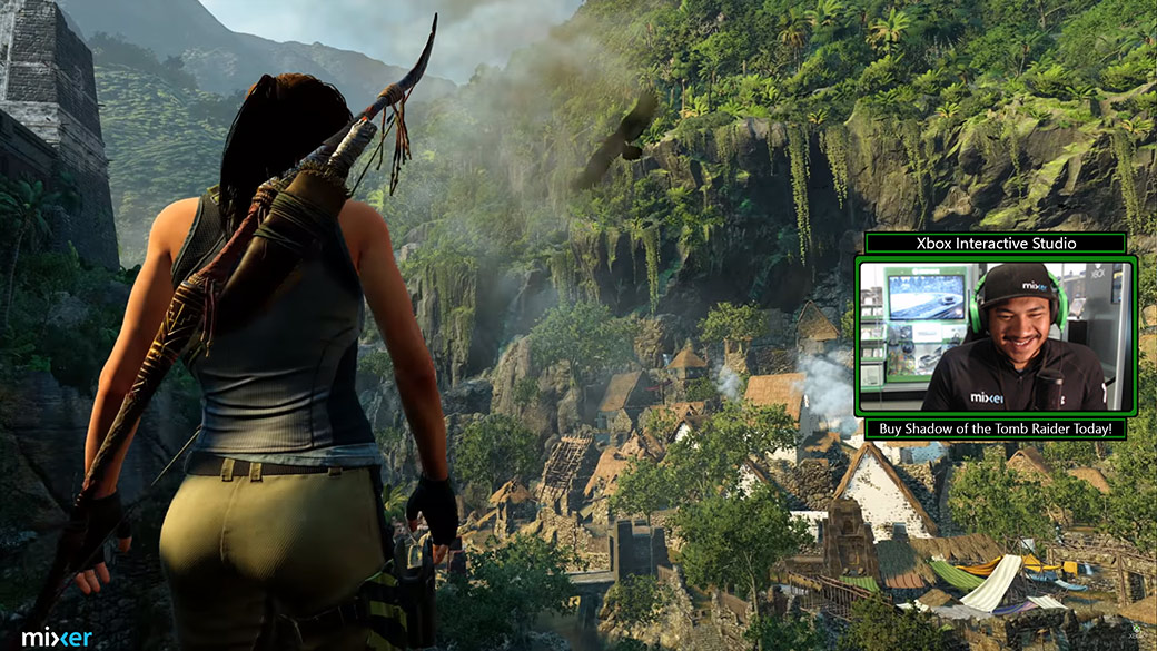 Stream of man playing Shadow of the Tomb Raider, Backside view of Lara as she stands on a cliff overlooking a village
