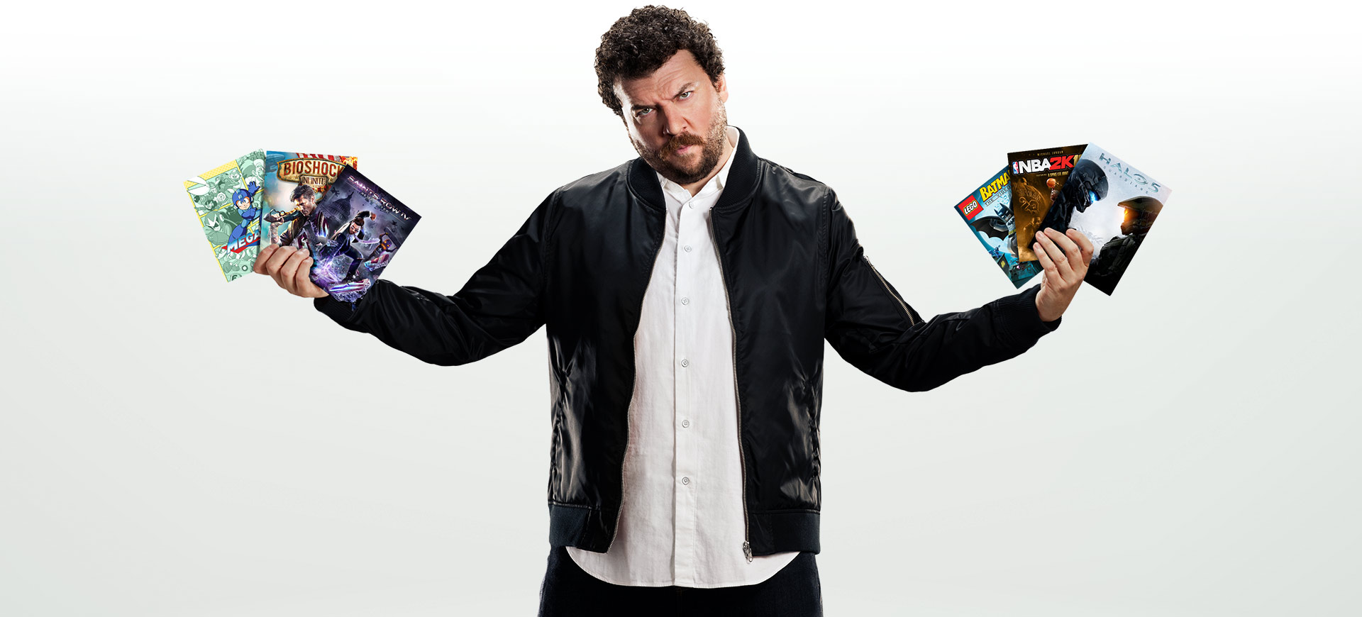 Danny McBride holding Xbox game pass games