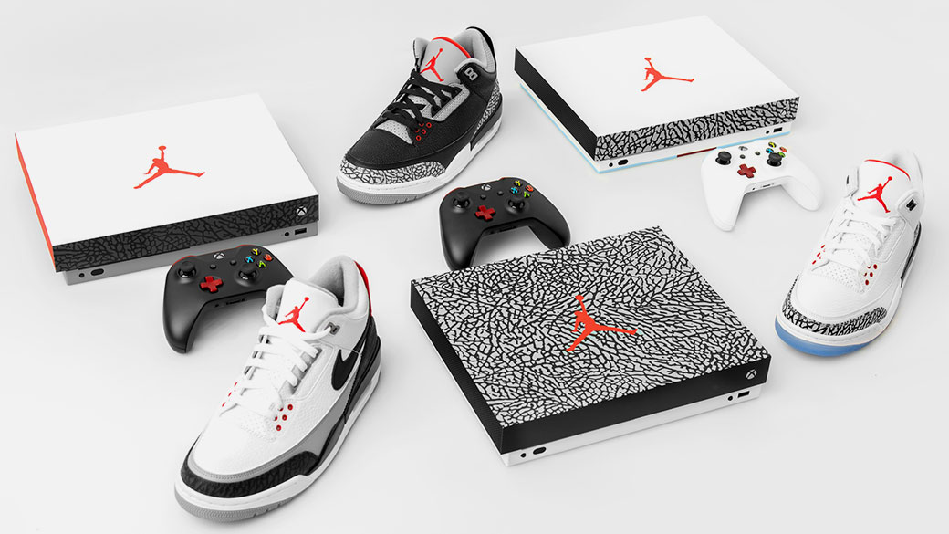 Front view of 3 Xbox One X Jordan Special Edition console, 3 ID Xbox Wireless Controller, and 3 Jordan Basketball shoes