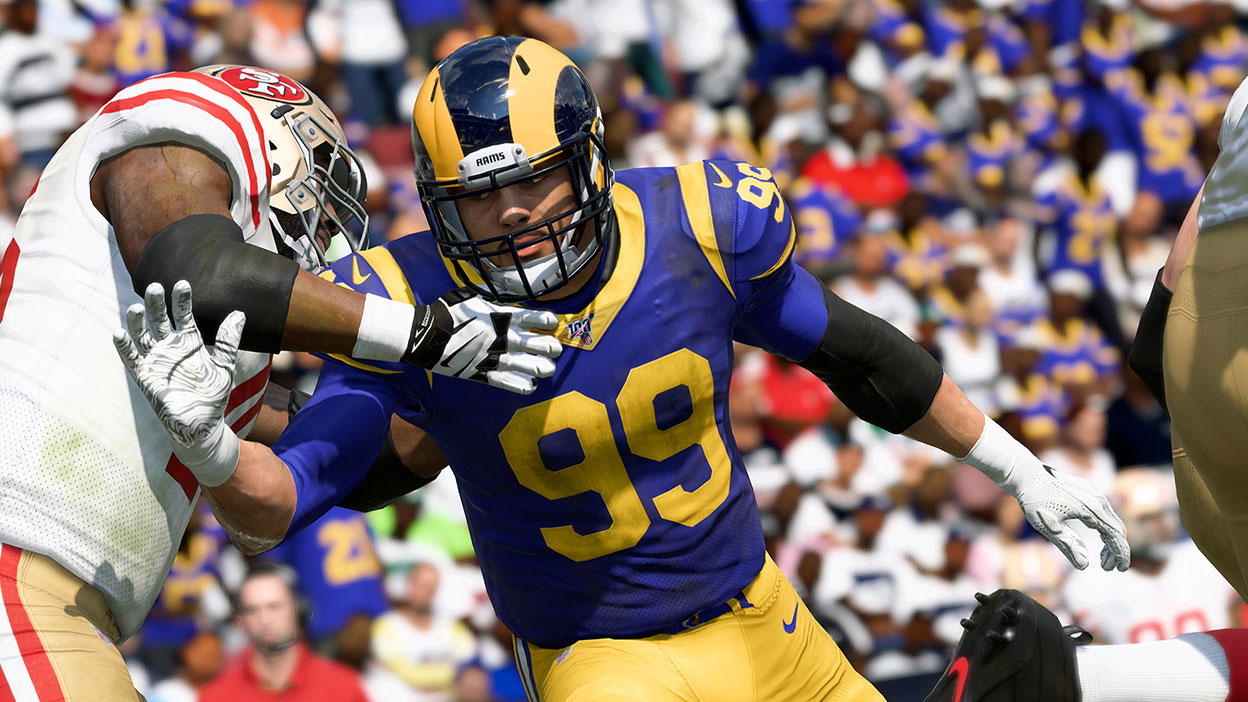 Rams player Aaron Donald wearing navy blue and gold
