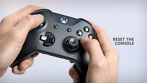 A closeup of a pair of hands holding an Xbox controller, with a headline