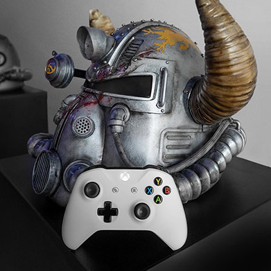 Fallout 76 armor helmet and and white Xbox one controller