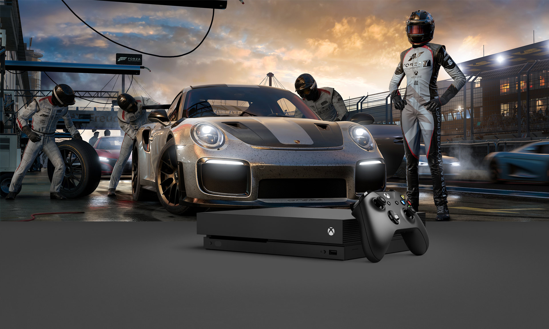 Xbox one X with Porsche GT2 RS at a pit stop in the background