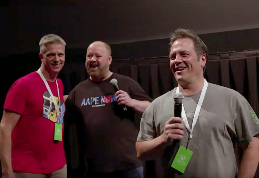 Phil Spencer smiling with the E3 production crew backstage