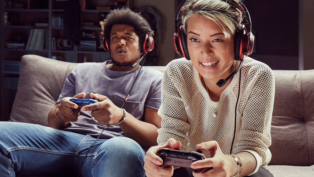 two people playing xbox together