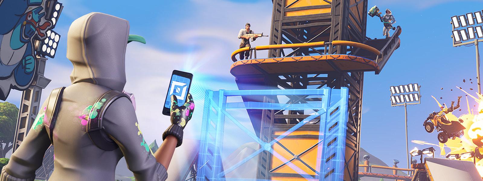 Un personaggio usa il telefono per creare un nuovo elemento nel gioco