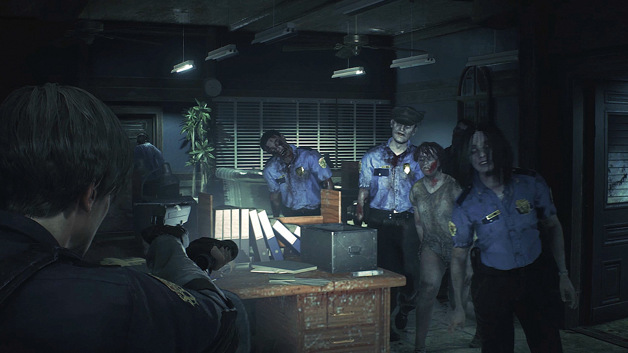 A group of zombies walk toward Leon Kennedy in an office in a police station