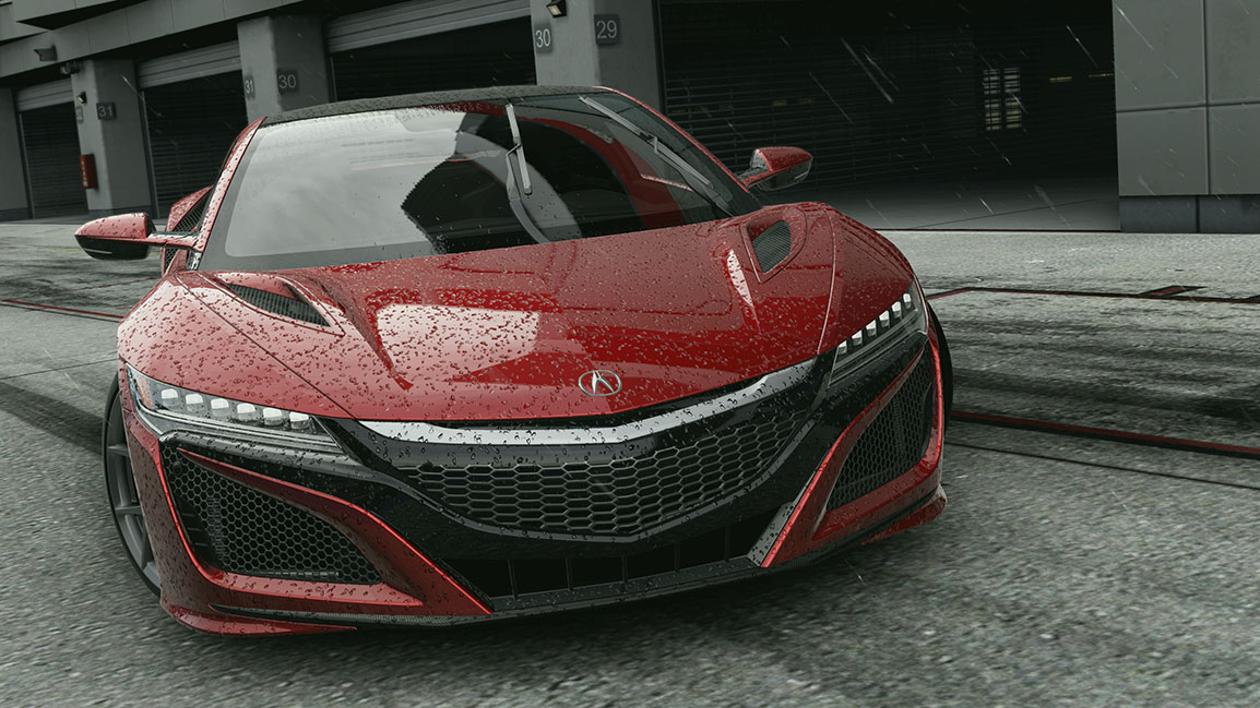 Front view of a stationary Acura NSX in front of garages