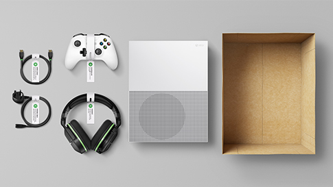 An overhead shot of various Xbox components, including console and controller, labelled and ready to go into a box