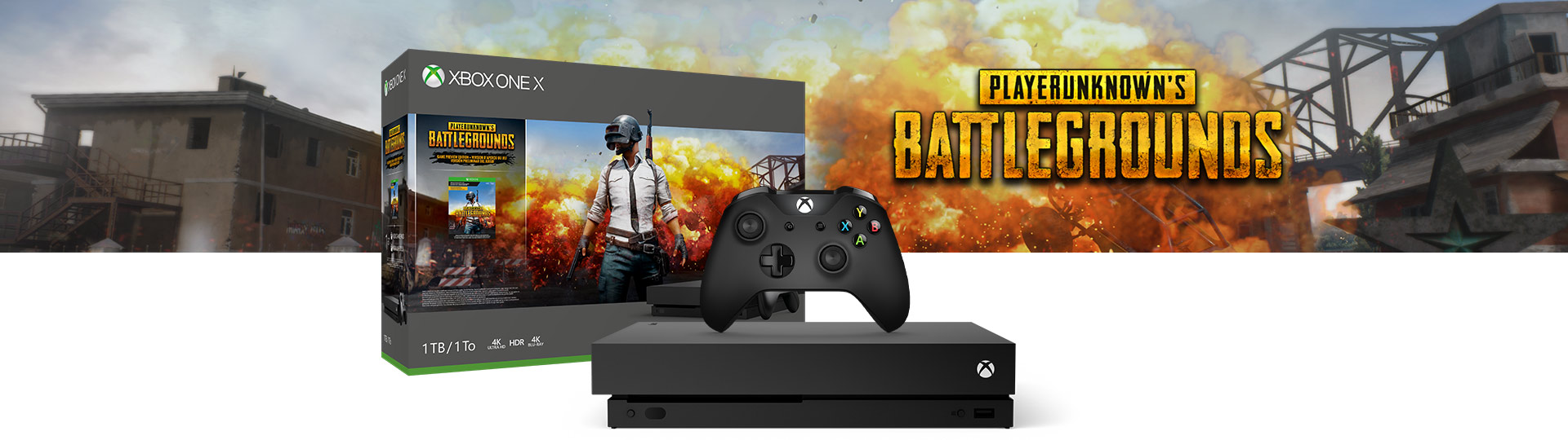 Xbox One X PlayerUnknowns Battlegrounds 1 terabayt ürün kutusunun yanında duran Xbox One X ve Oyun Kumandası