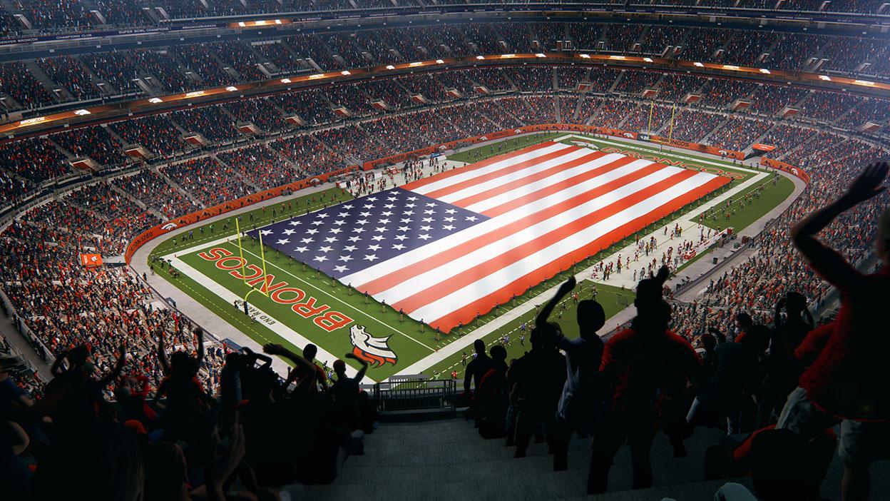 Una bandera estadounidense gigante extendida por el campo del estadio de Denver.