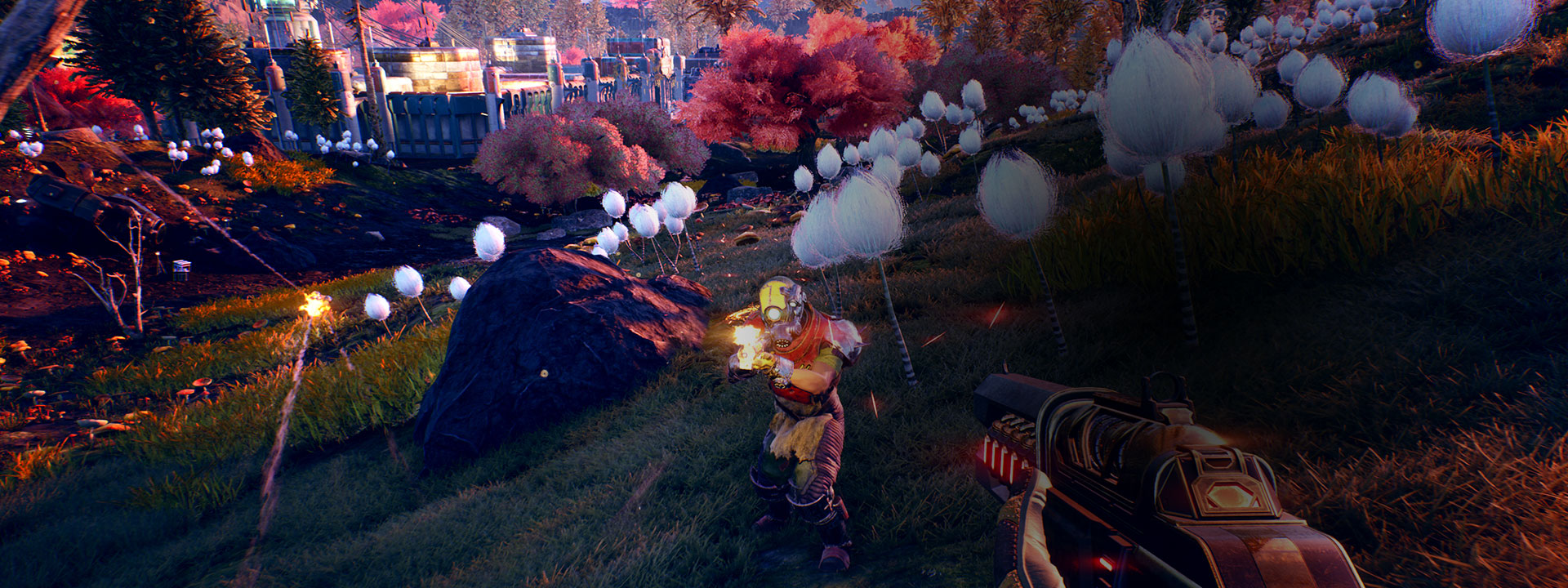 First person view of the player character in a field facing human enemies with guns
