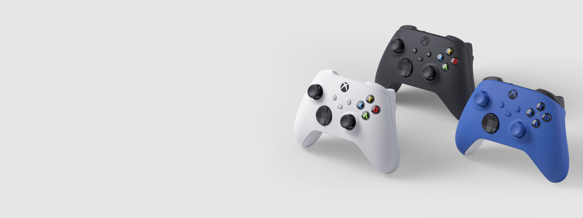 White, Black, and Blue Xbox Wireless Controllers