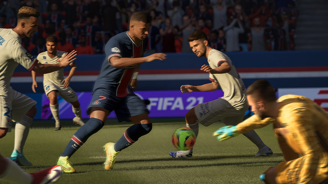 Mbappe in FIFA 21 dribbling a ball past three players and a goalie