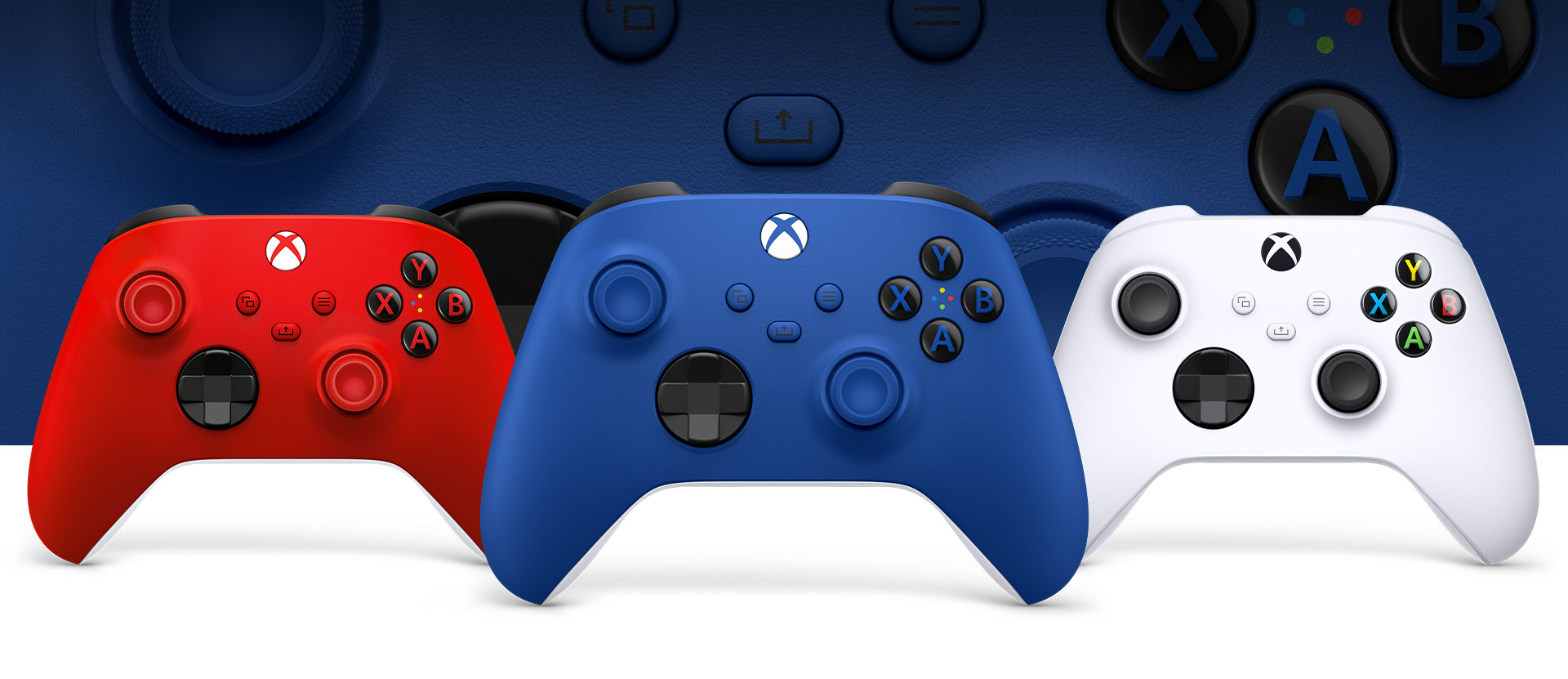 Xbox Shock Blue controller in front with the robot white and Pulse Red controllers beside it