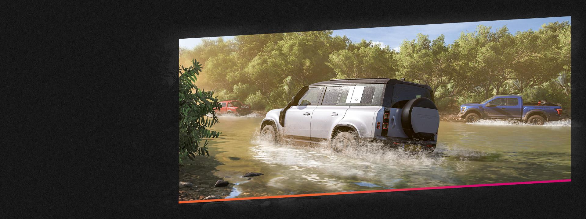 강을 따라 달리는 자동차 세 대.