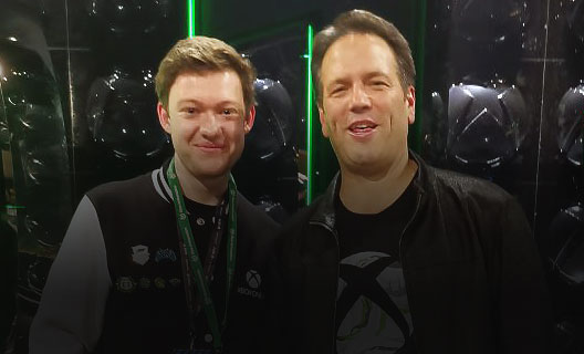 Eden stands with Phil Spencer, executive vice president of gaming at Microsoft.