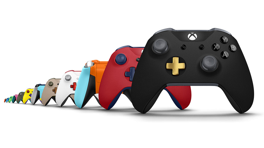 Various Xbox Design Lab Controllers in a row - Black, Red, Orange, White