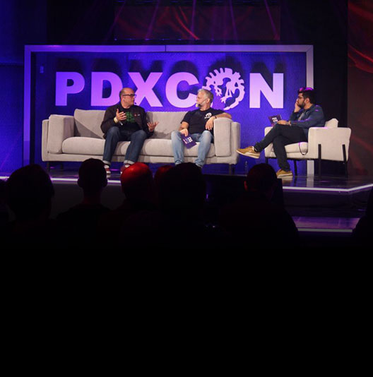 Developers discuss announcements on the PDXCON 2019 stage