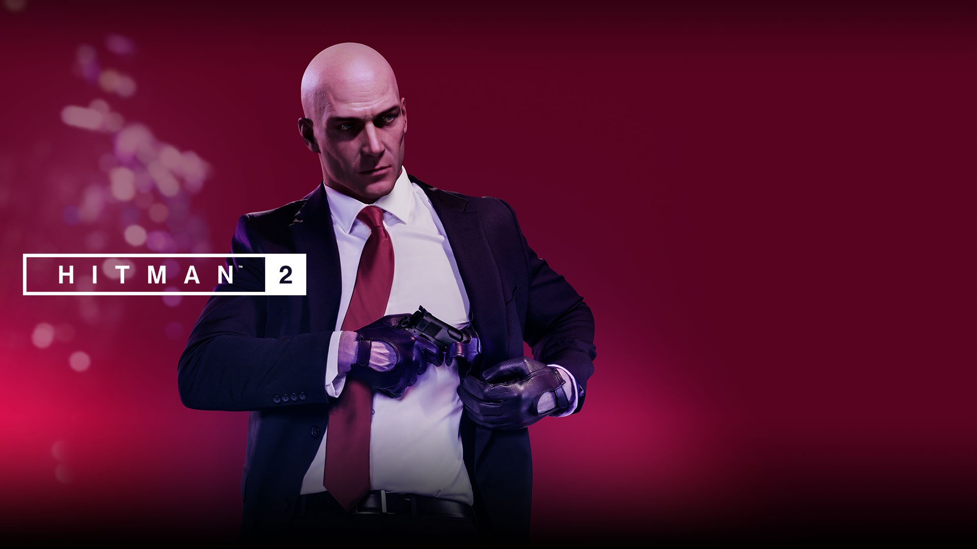 Hitman 2, Agent 47 pulls a pistol from a holster hidden in his jacket.