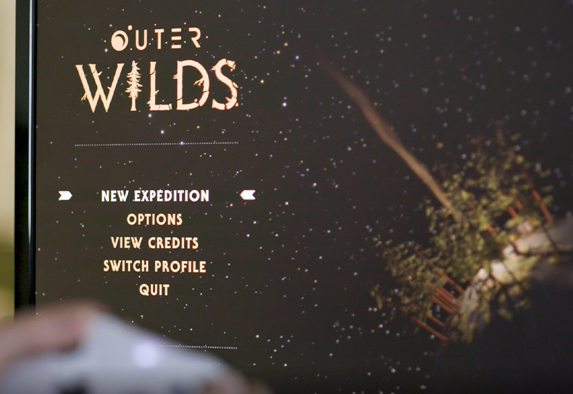 TV screen showing the title screen of the game Outer Wilds