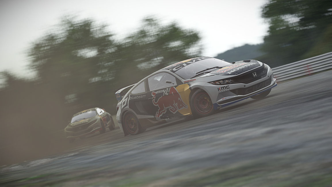 Click to enlarge: A Red Bull sponsored Honda Civic leads in a Rallycross race against another Honda Civic