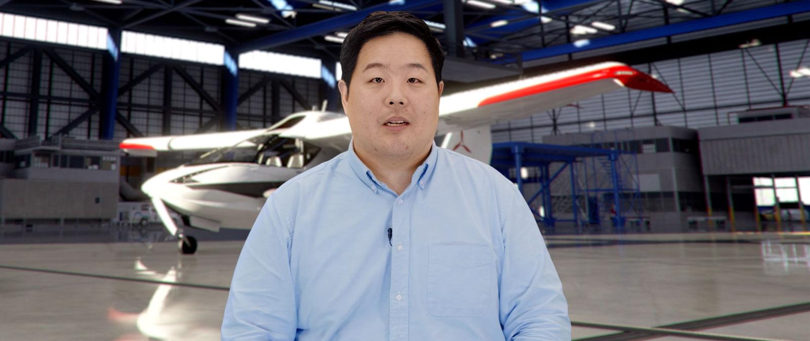 DEEKAY talking in front of a plane