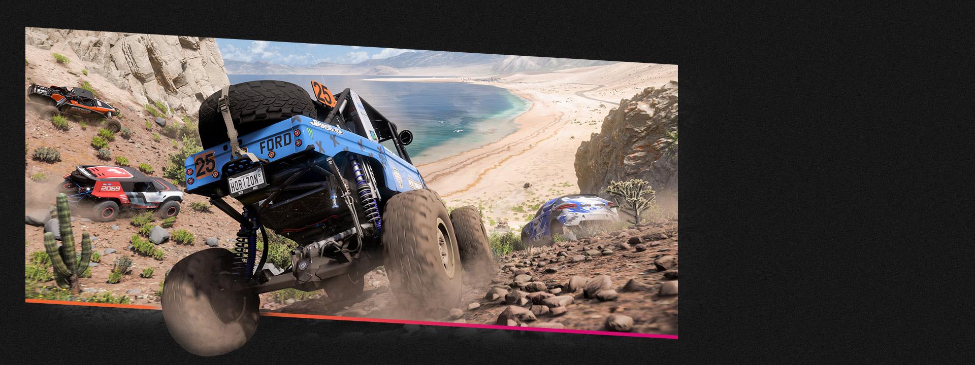 흙 언덕에서 아래쪽 해변을 향해 경주하는 자동차 네 대.