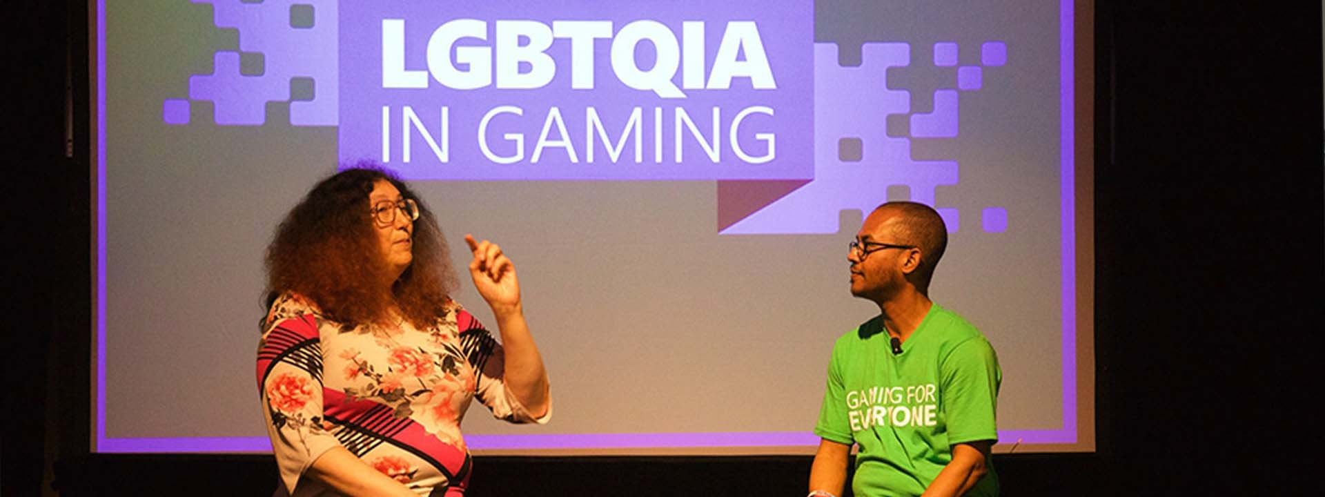 Two gaming industry professionals from the LGBTQIA community speak on stage