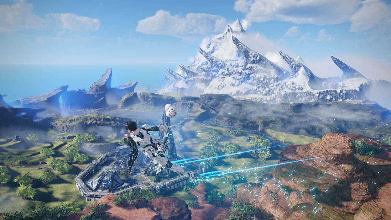 Character in armour flying around with a drone above a field with a base by a green valley and snowy mountains