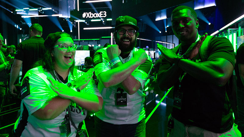 Three FanFest patrons making an X with their arms