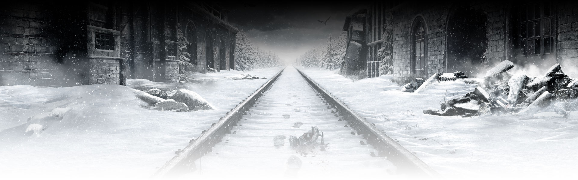 Snow-covered rail road track with footprints in the snow.