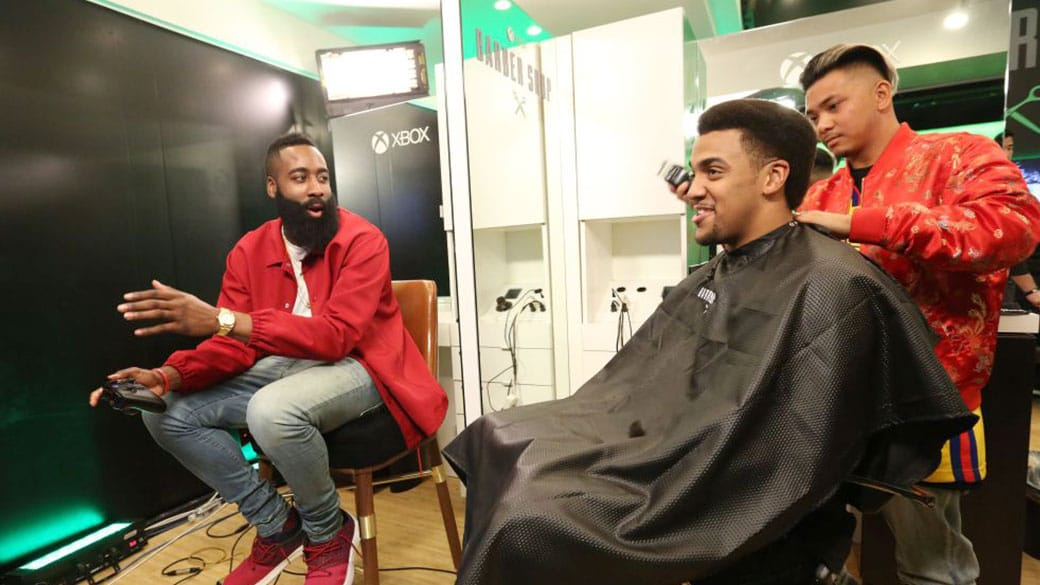 James Harden playing on Xbox and talking to someone getting a haircut
