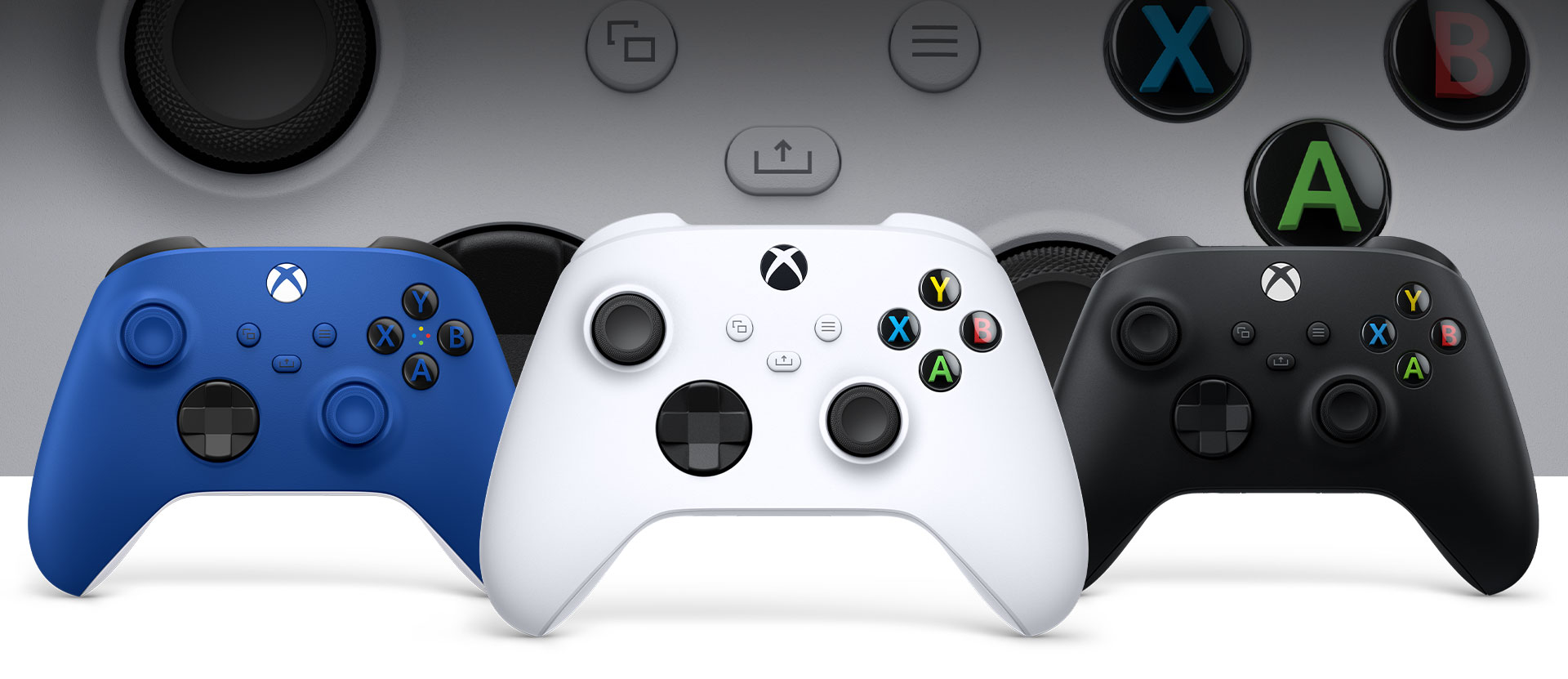Xbox Robot controller in front with the Carbon xbox and shock blue controllers beside it