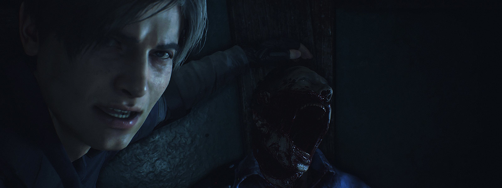 Leon Kennedy looks toward the camera as his hand rests above a dead zombie's head