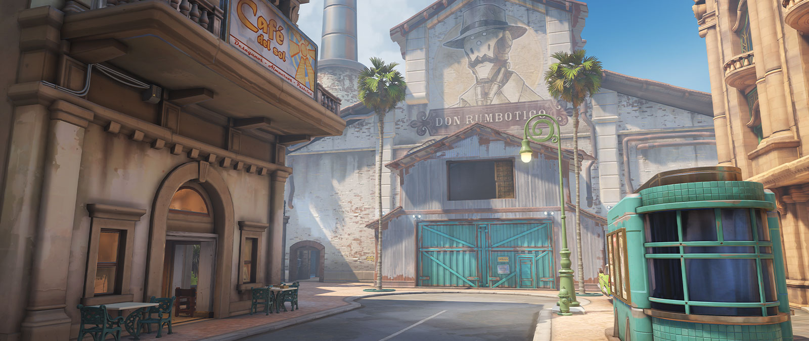 Overwatch Havana Map featuring dusty buildings and a barn with a picture of a robot in a top hat painted on it.