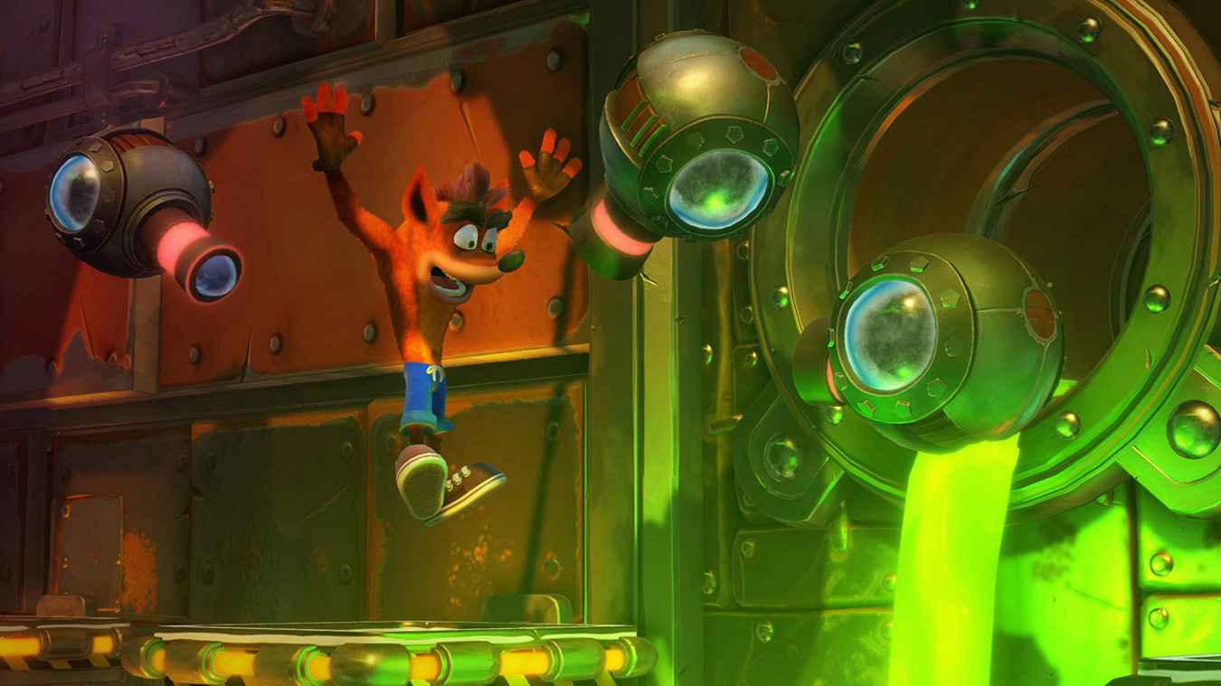 Crash jumping above a grated platform in front of green ooze