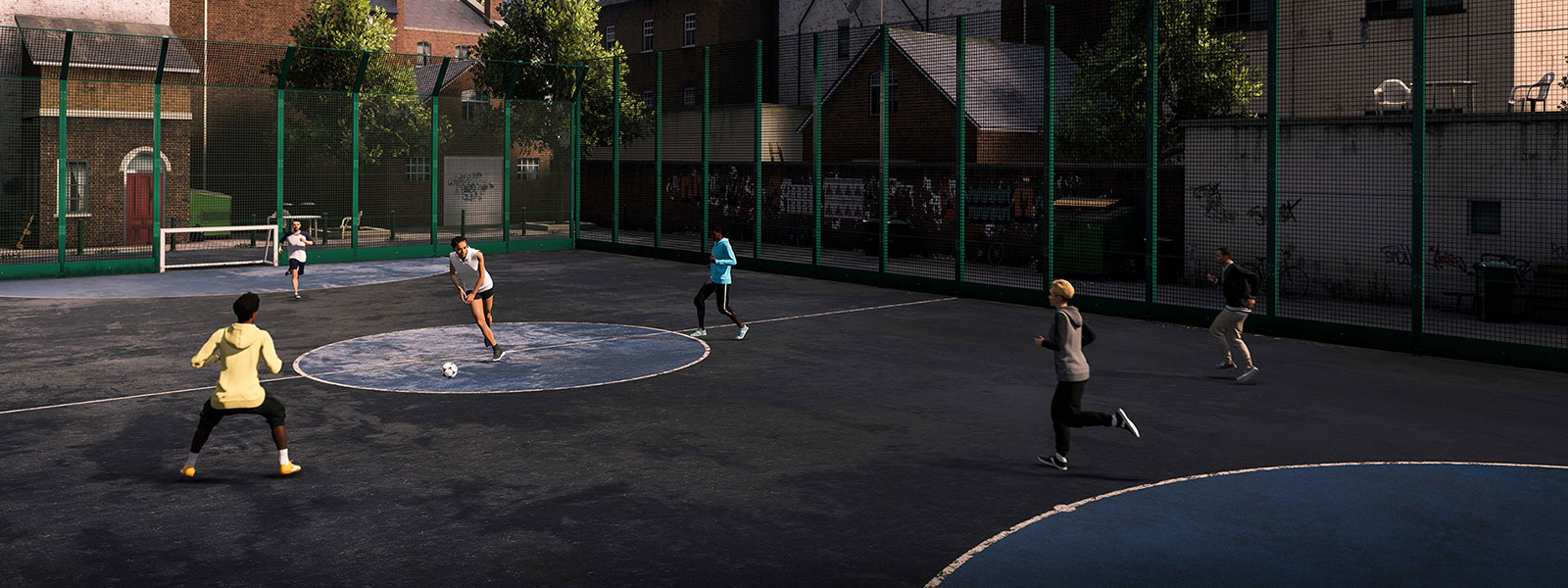 Six people playing street football in a neighbourhood cage