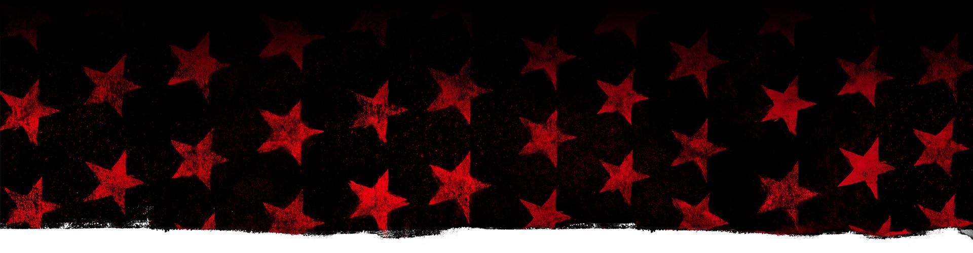Estrelas vermelhas contra um fundo preto.