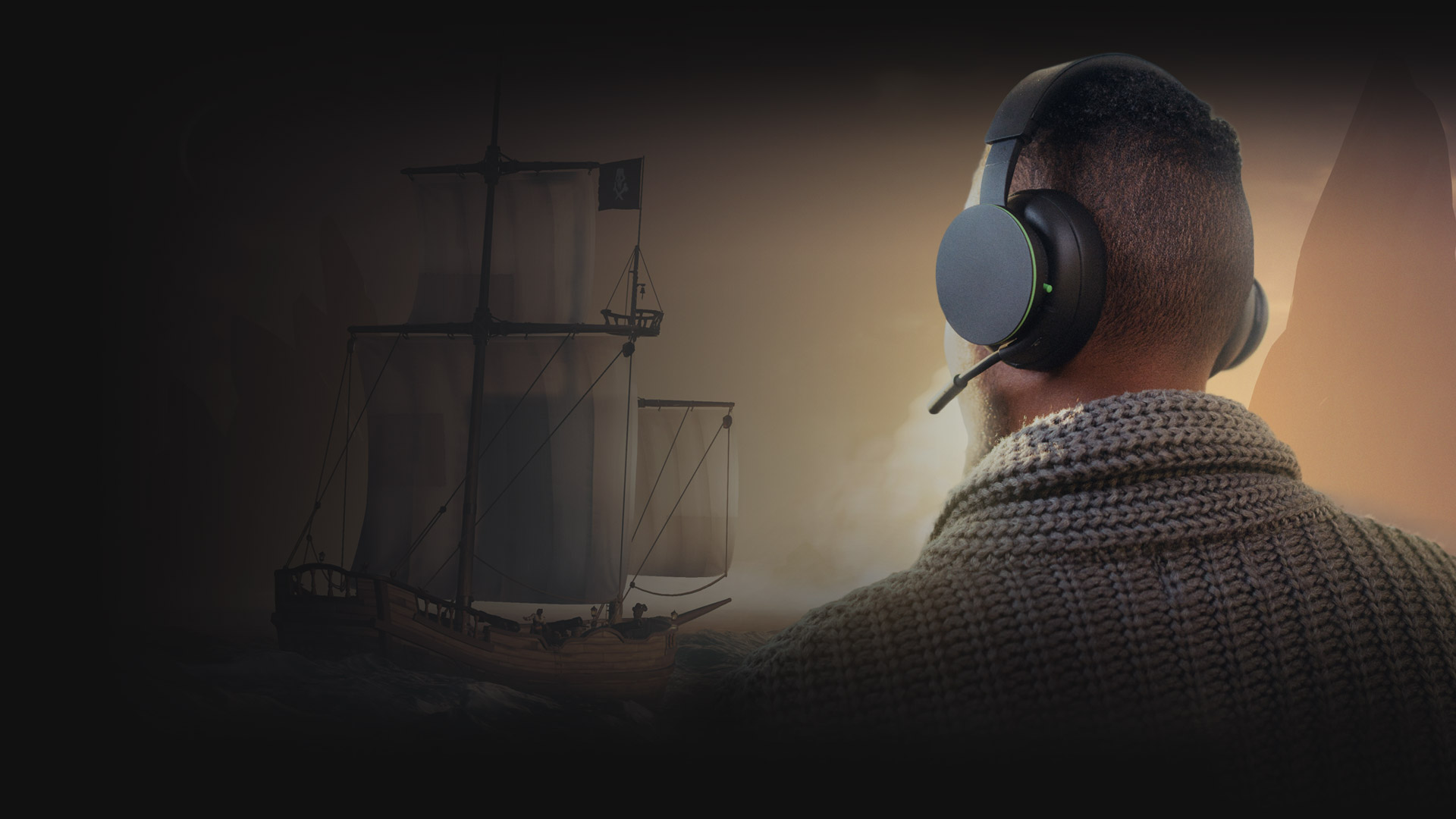 A man looks out over the vast Sea of Thieves, with the Xbox Wireless Headset keeping his communication with his crewmates clear.