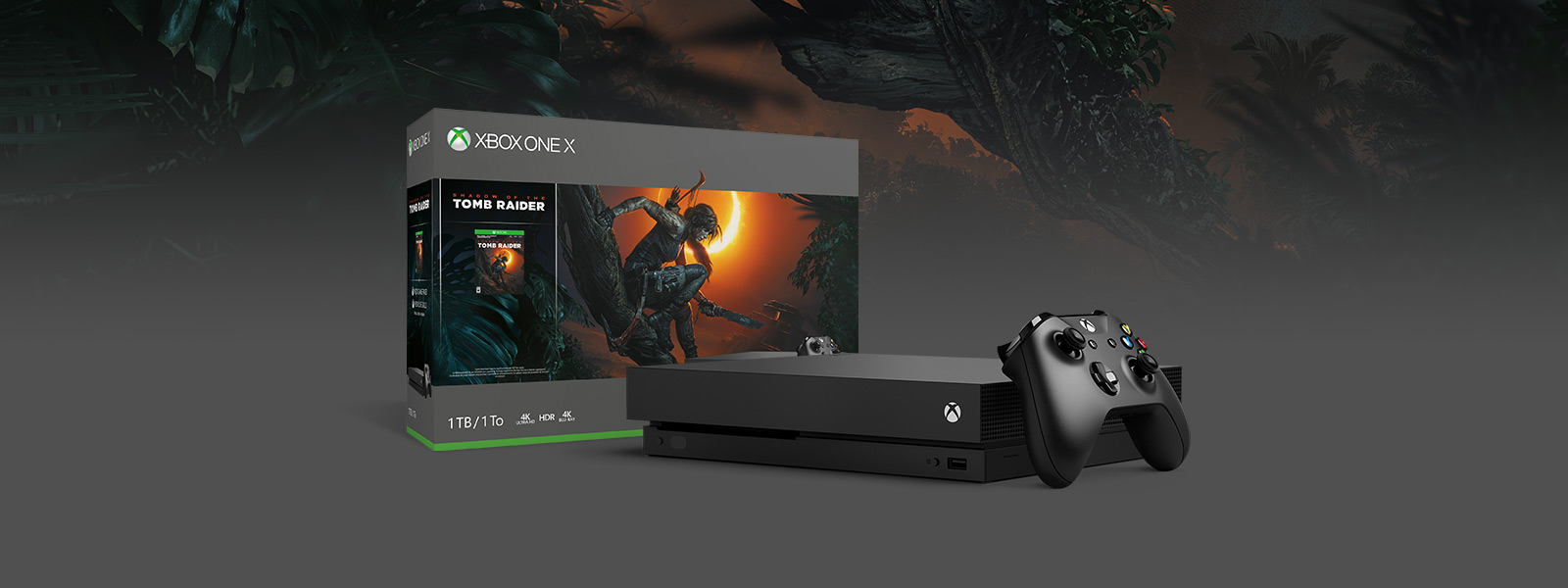 Box and console shot of Xbox One X Shadow of the Tomb Raider Bundle (1TB), background of in game forest
