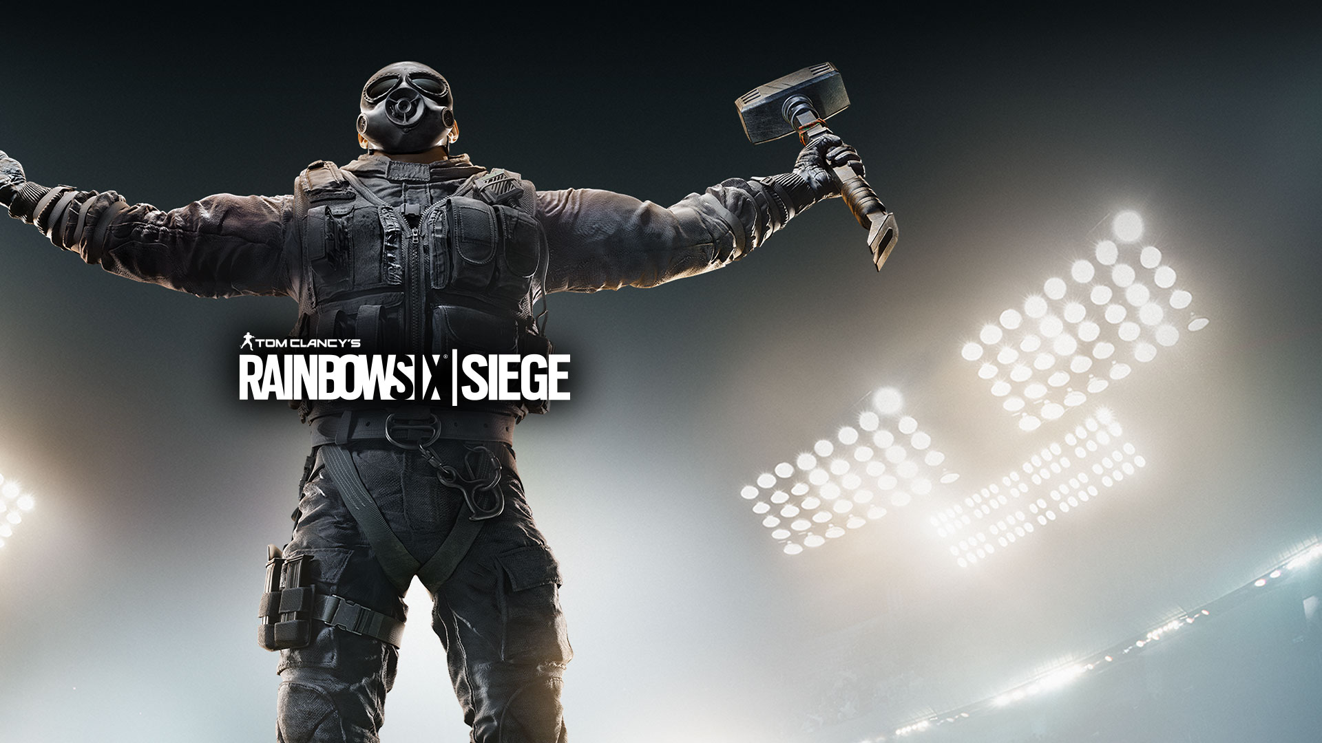 Tom Clancy's Rainbow Six Siege, Operator Sledge raises his arms with a lit stadium in the background.