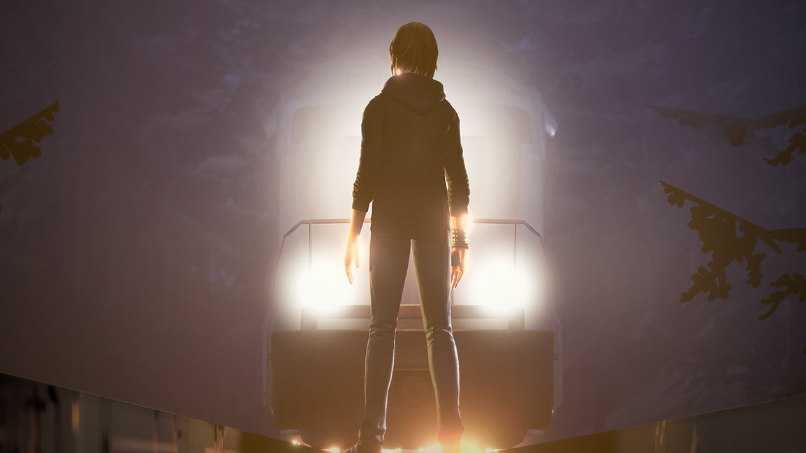 Chloe stands in front of an oncoming train